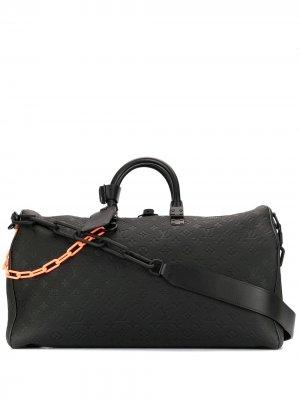 Сумка Keepall pre-owned ограниченной серии с монограммой Louis Vuitton. Цвет: черный