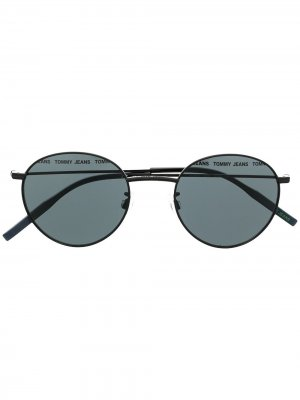 Солнцезащитные очки в круглой оправе Tommy Jeans. Цвет: черный