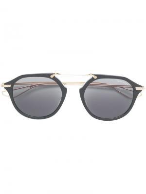 Затемненные солнцезащитные очки в круглой оправе Dita Eyewear. Цвет: черный