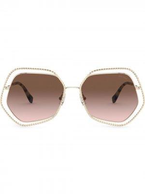 Солнцезащитные очки La Mondaine в массивной оправе Miu Eyewear. Цвет: золотистый