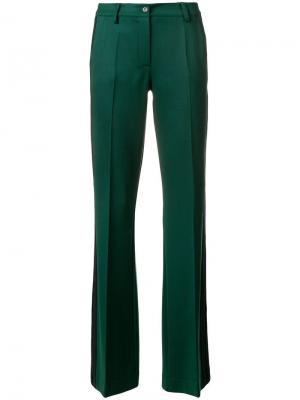 Расклешенные брюки строгого кроя P.A.R.O.S.H.. Цвет: зеленый