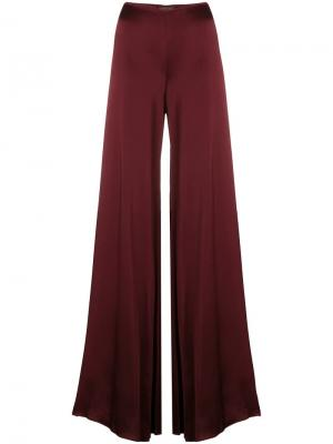 Блестящие расклешенные брюки Romeo Gigli Pre-Owned. Цвет: красный