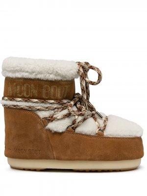 Зимние ботинки с отделкой из овчины Moon Boot. Цвет: белый