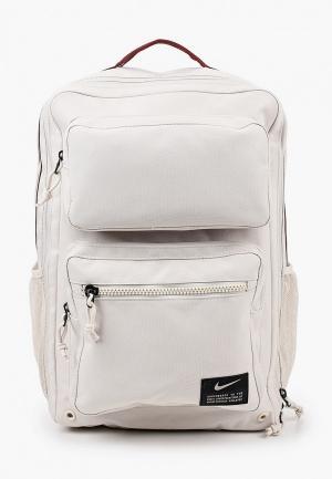 Рюкзак Nike. Цвет: бежевый