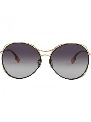 Солнцезащитные очки в массивной оправе Burberry Eyewear. Цвет: золотистый