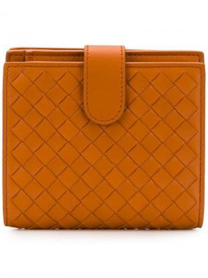 Кошелек с плетением intrecciato Bottega Veneta. Цвет: оранжевый
