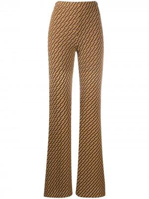 Расклешенные брюки Riva Beaufille. Цвет: желтый