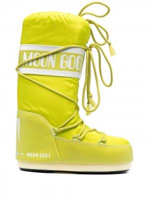 Зимние сапоги со шнуровкой Moon Boot. Цвет: желтый
