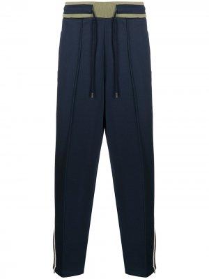 Спортивные брюки с лампасами Fred Perry. Цвет: синий