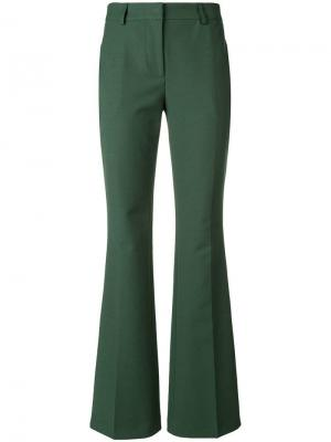 Слегка расклешенные брюки Calvin Klein. Цвет: зеленый