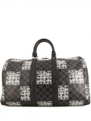 Дорожная сумка Keepall 45 pre-owned 2015-го года Louis Vuitton. Цвет: черный