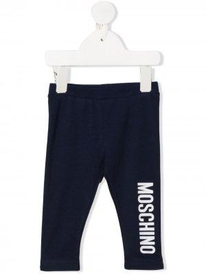 Легинсы с логотипом Moschino Kids. Цвет: синий