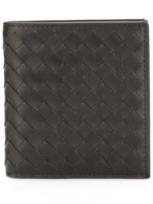 Бумажник с плетением Intrecciato Bottega Veneta. Цвет: коричневый